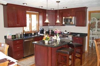 Clasic Kitchen photo of a kitchen after refacing in dark royal stained cherry beadboard doors.