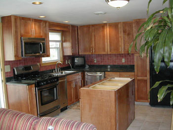 Classic Kitchen photo of a kitchen after refacing in Cherry stained maple with shaker door style.