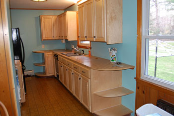 Classic kitchen photo of a kitchen after refacing in square raised panel natural maple.