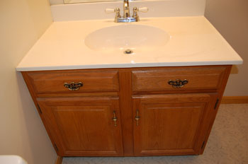Classic kitchen photo of a vanity before refacing.