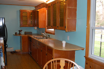 Classic Kitchen photo of a kitchen before refacing.